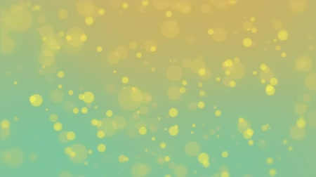 чирок : Colorful teal orange particle background with glowing yellow bokeh lights. Стоковые видеозаписи