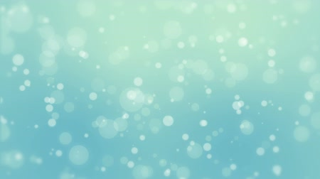 боке : Glowing blue green bokeh background with floating light particles.