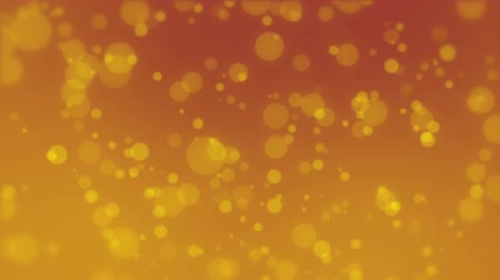 stardust : Glowing dark orange golden bokeh background with moving light particles.