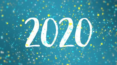 böjti réce : Sparkly blue yellow Happy New Year 2020 greeting card video animation with falling colorful glitter particles. Stock mozgókép