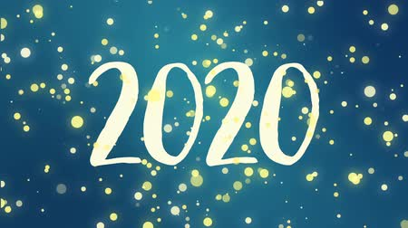 böjti réce : Teal blue Happy New Year 2020 greeting card video animation with handwritten numbers and falling sparkly yellow particles. Stock mozgókép