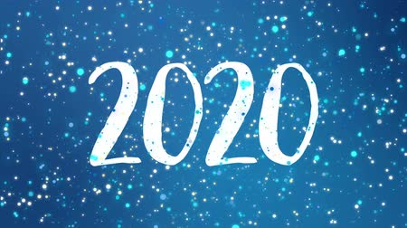 мерцание : Sparkly Happy New Year 2020 greeting card video animation with falling snowflakes and colorful glitter particles flickering on blue background. Стоковые видеозаписи