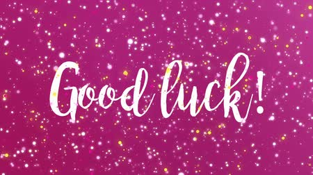 övgü : Sparkling purple pink Good luck animated greeting card with handwritten text.