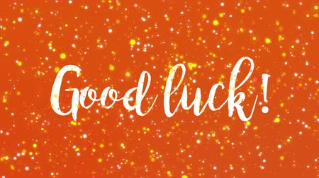 frase : Sparkling orange Good luck animated greeting card with handwritten text.