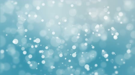 stardust : Animated winter background with glowing light bokeh particles floating against blue backdrop.