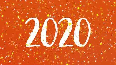 manuscrita : Sparkly Happy New Year 2020 greeting card video animation with handwritten numbers and colorful glitter particles flickering on orange background.