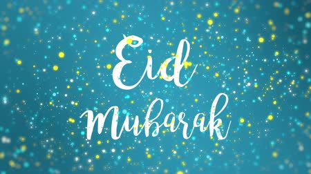 böjti réce : Sparkly Eid Mubarak greeting card video animation with handwritten text and falling colorful glitter particles on teal blue background.
