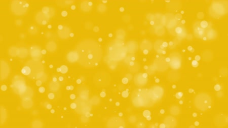 fireworks : Bright animated golden yellow bokeh background with glowing light particles. Stock Footage