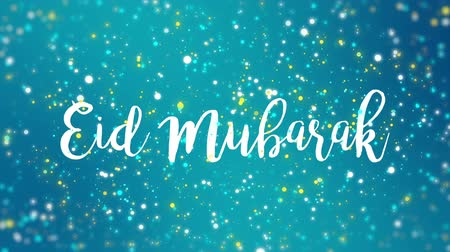 böjti réce : Sparkly Eid Mubarak greeting card video animation with handwritten text and colorful glitter particles flickering on turquoise blue background. Stock mozgókép