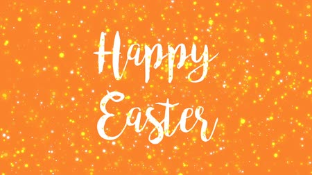 tremulação : Sparkly Happy Easter greeting card video animation with handwritten text and colorful glitter particles flickering on orange background.