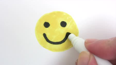 smilies : Painting a Smiley - Time Lapse Stock Footage