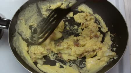 scrambled eggs : Preparing Scrambled Eggs Stock Footage