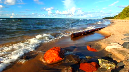 felső : Waves along the beach of Lake Superior in northern Michigan under beautiful sunlight