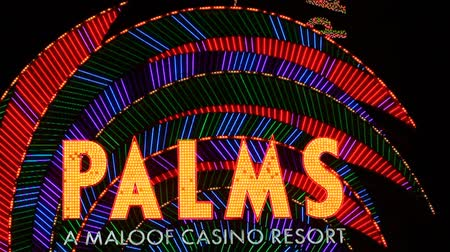 flaming : Las Vegas, USA - November 30, 2011: The Palms Resort Casino is a modern styled hotel and casino that opened in 2001 in Las Vegas.  Seen here is the elaborate brightly colored main entrance sign off Flamingo Road.