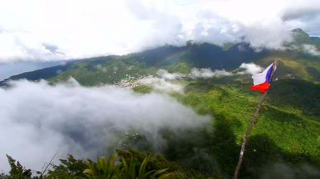небесный : View of Soufriere from the cloud covered summit of the Petit Piton on the Caribbean island of St Lucia Стоковые видеозаписи