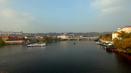 prague bridge : Pleasure boats time lapse motion on vltava river in Prague Stock Footage