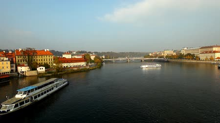 prague bridge : Pleasure boats move on river - view from karlov bridge, Prague, czech republic Stock Footage