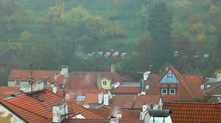 Прага : Old Prague roofs at autumn morning with smoke from pipe