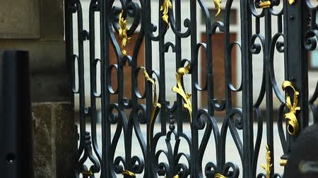 bordas : Metal fence on gate and tourist walk at background