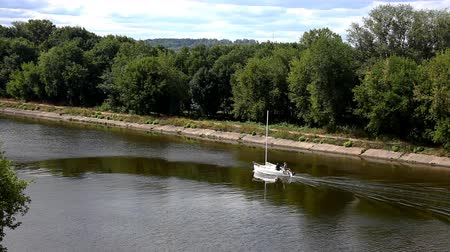 rzeka : Small barge floating on the river