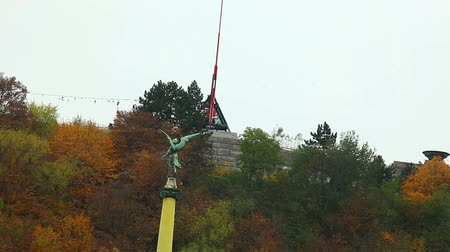 cseh : Prague Metronome monument in autumn forest Stock mozgókép