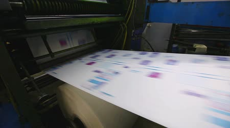 print shop : print shop typography machine work with cmyk color Stock Footage
