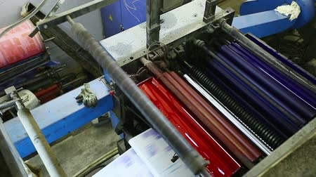 print shop : top view on print shop machine detail with color