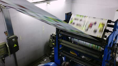 print shop : print press color typoghraphy machine in work