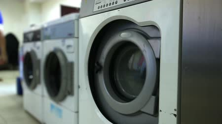 komerční : View of washing machines in laundry room, close-up