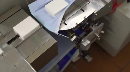 cheese packaging : Production line machinery processing milk products Stock Footage