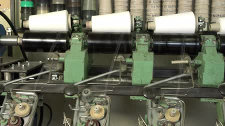 işlenmiş : White thread spools at automatic rewinding machine