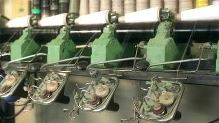 pletený : Rewinding machine at knitting shop close up video
