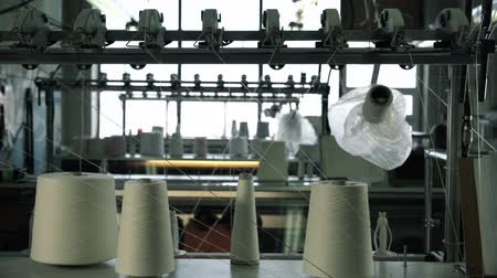 knitted : Spools with white thread at rewinding machines Stock Footage