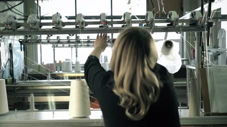 işlenmiş : Woman working at thread rewinding machine video