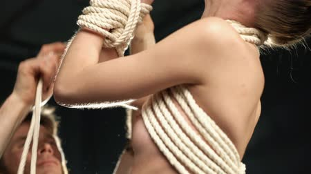 üstsüz : Nude girl tied up in shibari art style video