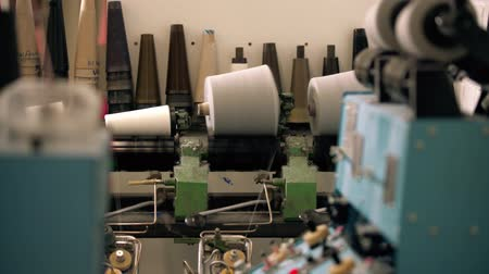 felülnézet : Spools of thread on knitting machine video
