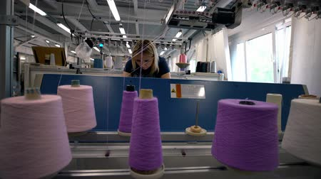 preso : Spools of pink thread on knitting machine view