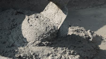 cement mixing in tray for bricklayer, HD 1920x1080 format Стоковые видеозаписи