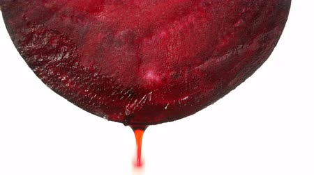 beetroot with dripping clear juice on white background