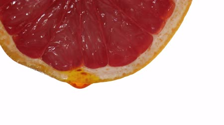 grapefruit with dripping clear juice on white background Wideo