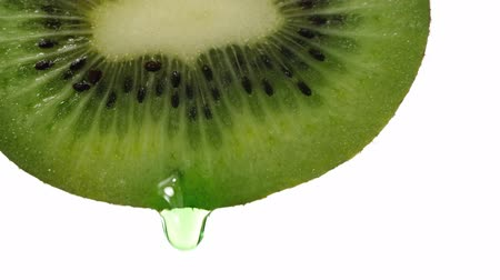 kiwi with dripping clear juice on white background