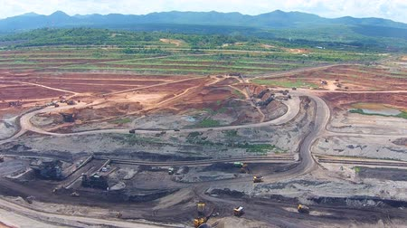 mayın : Aerial view shot for Mining dump trucks working in Lignite coalmine lampang thailand Stok Video