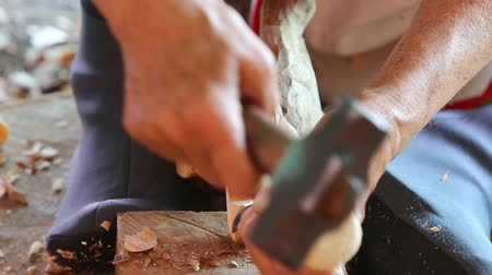 wood : Hand of carver carving wood Stock Footage