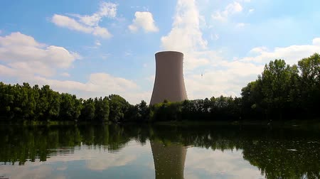 hatalom : Summer pond against nuclear power plant