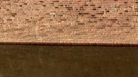 napfény : Brick wall and current river water in the sunlight