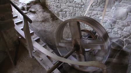 belting : Rotating cogwheel of the old wooden watermill Stock Footage