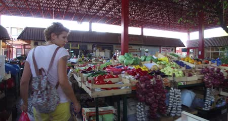 consumerism : Woman is shopping in the city food market Stock Footage