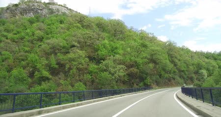 navíjení : Beautiful car from the window. Frontal view through a sunny spring day. Picturesque country roads of southern montenegro, mountains covered with green forest