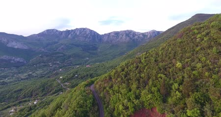 адриатический : Aerial helicopter shootings in Montenegro. The sun illuminates the top of the mountain