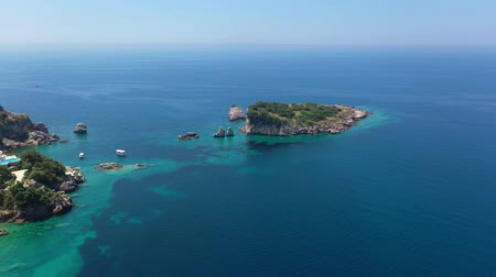 légi felvétel : Aerial shot, quadcopter flies along the rocky seashore, The sea water is turquoise, clean and clear